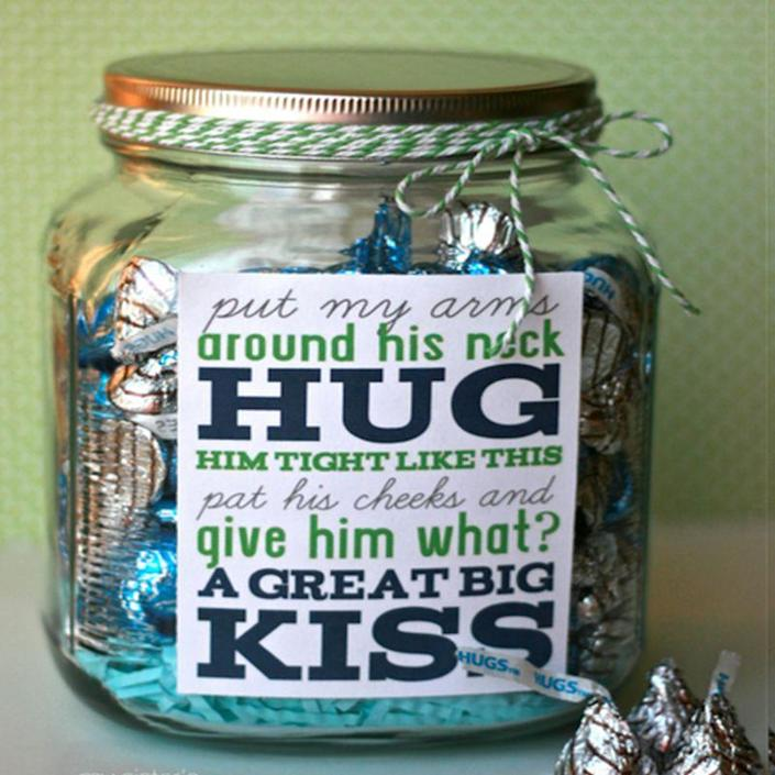 """<p>Although real hugs and kisses definitely take the cake, Dad will also surely appreciate a jar full of the chocolate hugs and kisses to sweeten his special day.</p><p><em>Get the tutorial at <a href=""""https://happymoneysaver.com/frugal-fathers-day-ideas/"""" rel=""""nofollow noopener"""" target=""""_blank"""" data-ylk=""""slk:Happy Money Saver."""" class=""""link rapid-noclick-resp"""">Happy Money Saver. </a> </em></p>"""