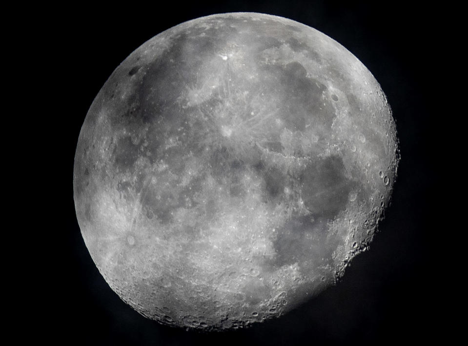 FILE - In this early Monday, Oct. 5, 2020, file photo, a waning moon is seen at the sky over Frankfurt, Germany. The moon's shadowed, frigid nooks and crannies may hold frozen water in more places and in larger quantities than previously suspected, good news for astronauts at future lunar bases who could tap into these resources for drinking and making rocket fuel, scientists reported Monday, Oct. 26, 2020. (AP Photo/Michael Probst, File)