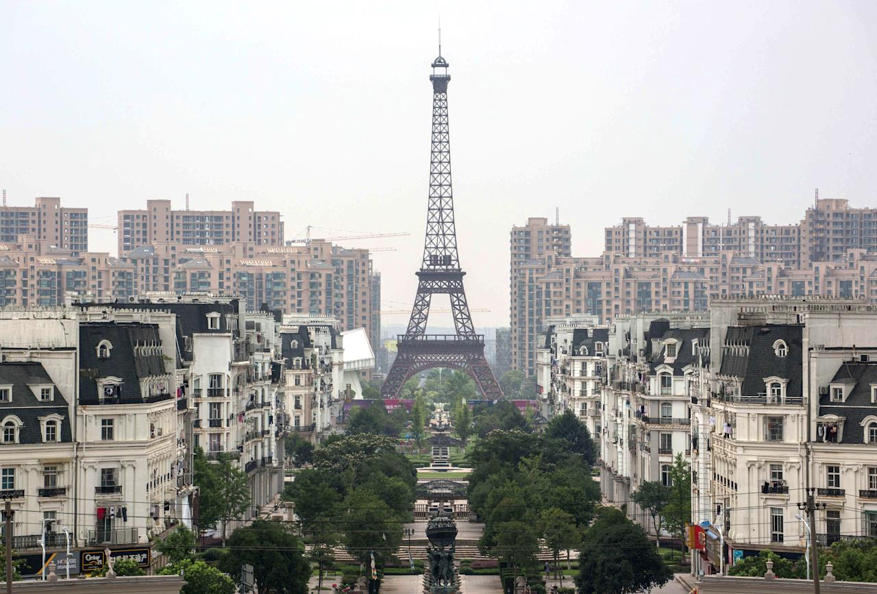 """No, this isn't a picture of post-apocalyptic <a href=""""https://www.cntraveler.com/destinations/paris?mbid=synd_yahoo_rss"""">Paris</a>. It's China's Tianducheng district, a miniature replica of France's capital, located about 40 minutes away from Hangzhou. The ambitious (yet failed) real estate development was built in 2007, complete with its own Champs-Elysées and 300-foot Eiffel Tower. Unfortunately, China's attempt to recreate the City of Light ended up being more creepy than romantic, as if the real Paris suddenly entered the <a href=""""https://www.cntraveler.com/story/stranger-things-pop-up-chicago?mbid=synd_yahoo_rss"""">Upside Down</a>. Only a couple thousand residents remain (the city was built to house 10,000), and the streets are typically empty—save for the occasional bridal party posing for faux Parisian wedding photos."""