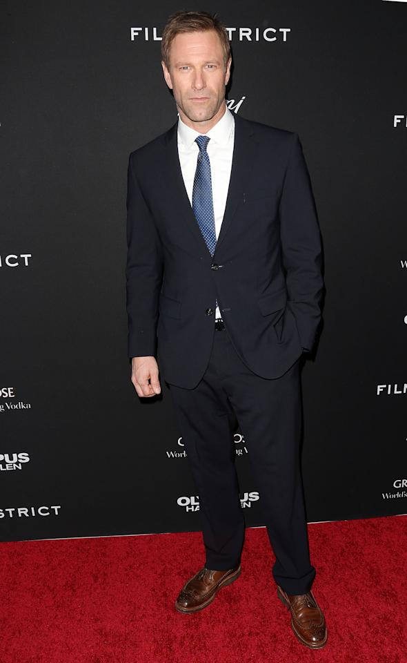 """HOLLYWOOD, CA - MARCH 18: Actor Aaron Eckhart attends the Premiere of FilmDistrict's """"Olympus Has Fallen"""" at the ArcLight Cinemas Cinerama Dome on March 18, 2013 in Hollywood, California.  (Photo by Frederick M. Brown/Getty Images)"""