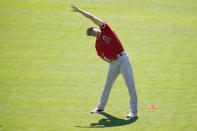 Los Angeles Angels designated hitter Shohei Ohtani (17) stretches during a baseball practice at Angels Stadium on Friday, July 3, 2020, in Anaheim, Calif. (AP Photo/Ashley Landis)