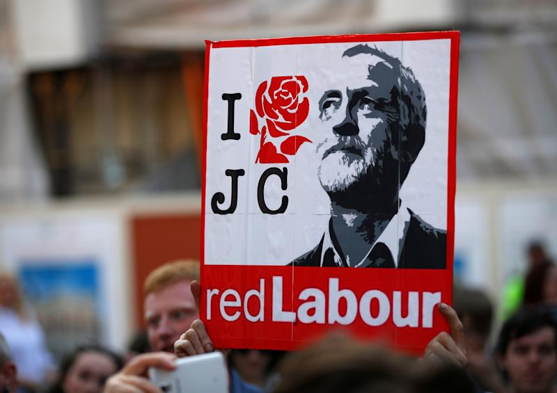 A Labour supporter holds up a picture of Jeremy Corbyn