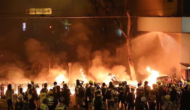 Protesters set fire to barricades on Hennessy Road in Wan Chai on August 31. Photo: Felix Wong