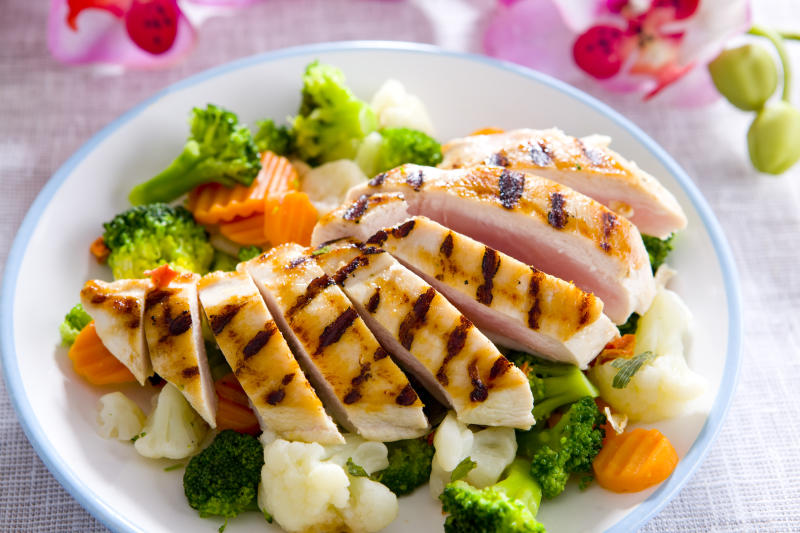 Picture of cooked chicken served with vegetables.