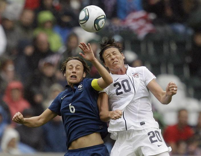 United States' Abby Wambach goes up for a header against France's Sandrine Soubeyrand during the semifinal match between France and the United States at the Women's Soccer World Cup in Moenchengladbach, Germany, Wednesday, July 13, 2011. (AP Photo/Marcio Jose Sanchez)
