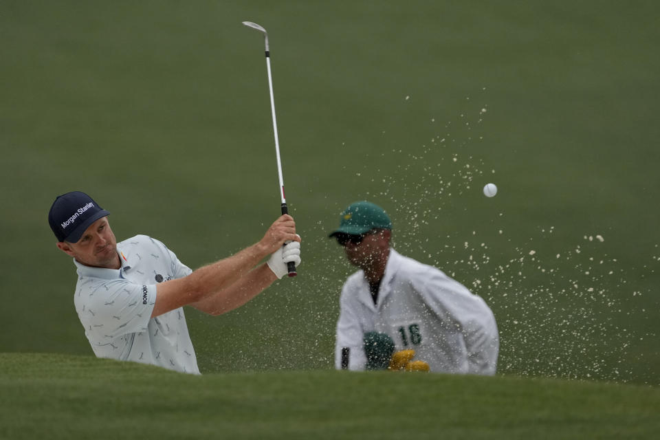 Justin Rose, of England, hits out of a bunker on the 15th hole during the first round of the Masters golf tournament on Thursday, April 8, 2021, in Augusta, Ga. (AP Photo/David J. Phillip)