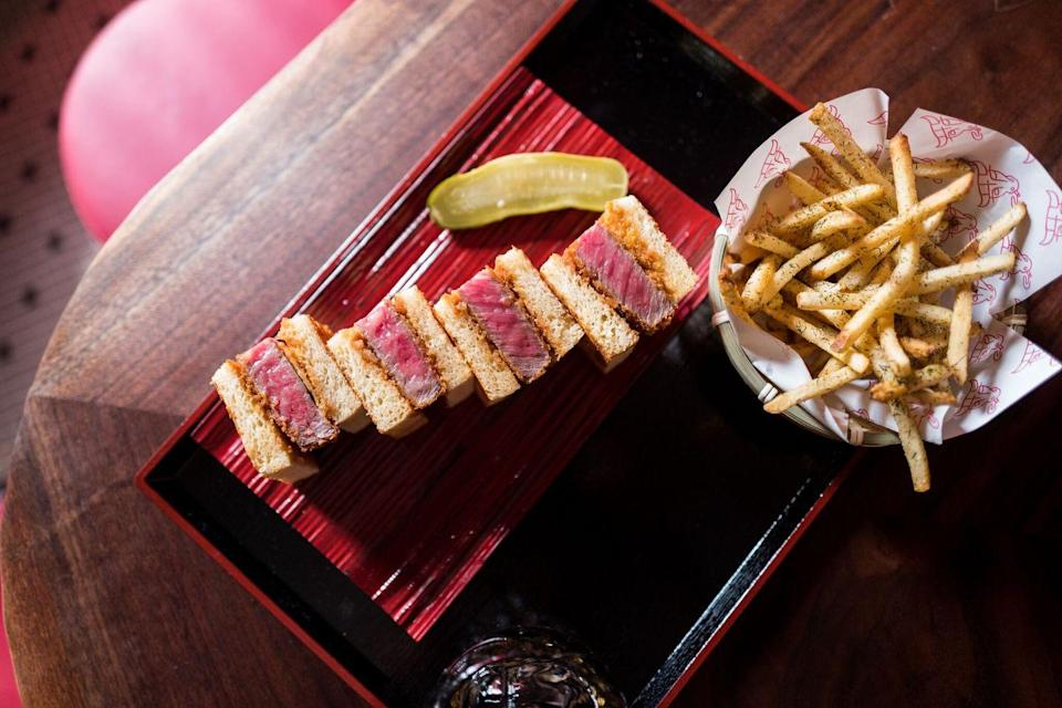 """<p>The first restaurant in New York to exclusively serve Wagyu beef sandwiches, <a href=""""http://donwagyu.net/"""" rel=""""nofollow noopener"""" target=""""_blank"""" data-ylk=""""slk:Don Wagyu"""" class=""""link rapid-noclick-resp"""">Don Wagyu</a> is located in the open-air Bowery Market. It offers up three sandwich-and-fry options that range from $28 to $180 (the top-of-the-line """"sando"""" is made with beef from five cattle shipped to the U.S. every month from a family-owned farm in the Miyazaki Prefecture in Japan). Only about 200 sandwiches are available per day.</p>"""