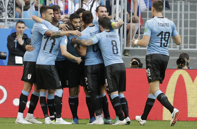Uruguay's Luis Suarez, centre, celebrates after scoring the opening goal during the group A match between Uruguay and Russia at the 2018 soccer World Cup at the Samara Arena in Samara, Russia, Monday, June 25, 2018. (AP Photo/Gregorio Borgia)
