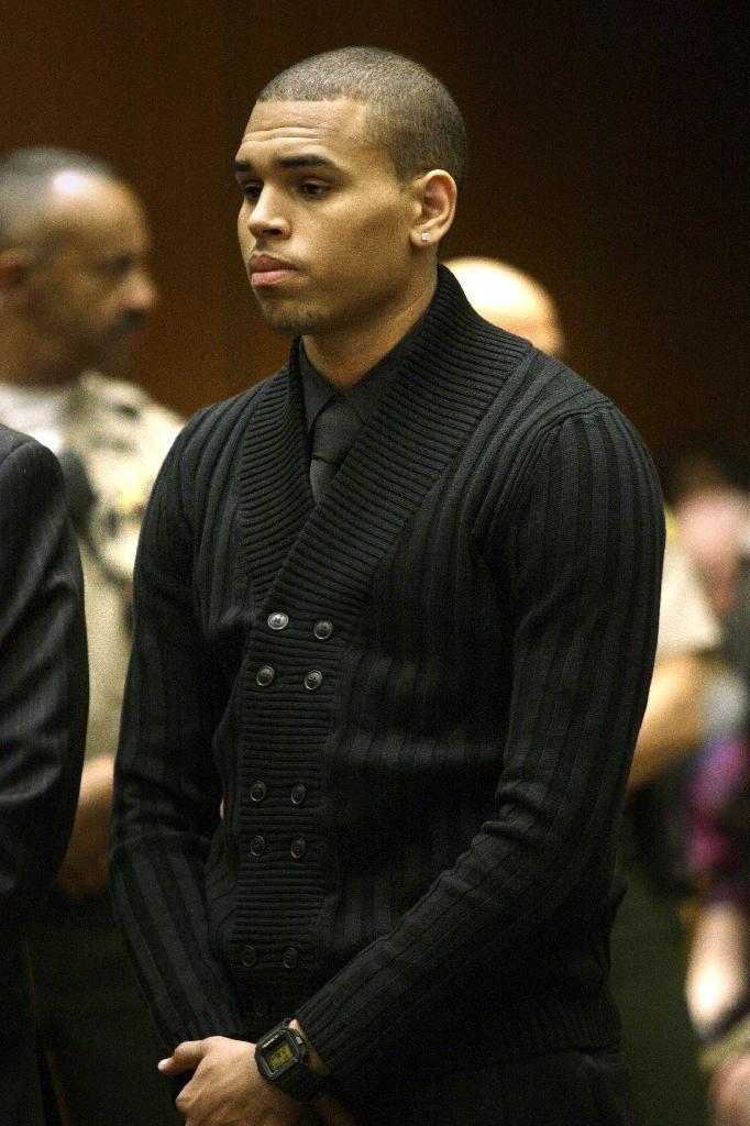 US singer Chris Brown appears at the Los Angeles Superior Court on April 6, 2009 for his arraignment for the assault of popstar Rihanna (AFP Photo/Damian Dovarganes)