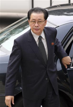 Jang Song Thaek, Chief of the Central Administrative Department of the Workers' Party of Korea, exits a car as he arrives at the Ziguangge building of Zhongnanhai, the central government compound, in Beijing, in this August 17, 2012 file photo. REUTERS/China Daily/Files