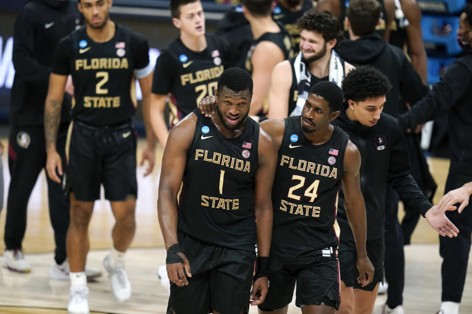 Florida State forward RaiQuan Gray (1) and guard Sardaar Calhoun (24) walk off the court after a Sweet 16 game against Michigan in the NCAA men's college basketball tournament at Bankers Life Fieldhouse, Sunday, March 28, 2021, in Indianapolis. Michigan won 76-58. (AP Photo/Jeff Roberson)
