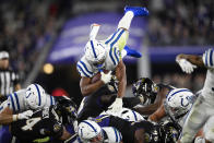 Indianapolis Colts running back Jonathan Taylor (28) dives for yardage over the pile during the second half of an NFL football game against the Baltimore Ravens, Monday, Oct. 11, 2021, in Baltimore. (AP Photo/Nick Wass)