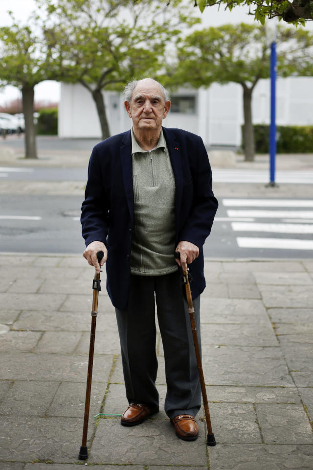 In this photo made Thursday, May 9, 2019, French World War II veteran Leon Gautier poses for a picture outside his house, in Ouistreaham, Normandy. He and his comrades in an elite French unit were among the first waves of Allied troops to storm the heavily defended beaches of Nazi-occupied northern France, beginning the liberation of western Europe. The commandos spent 78 days straight on the front lines, their numbers dwindling from one firefight to the next. (AP Photo/Thibault Camus)