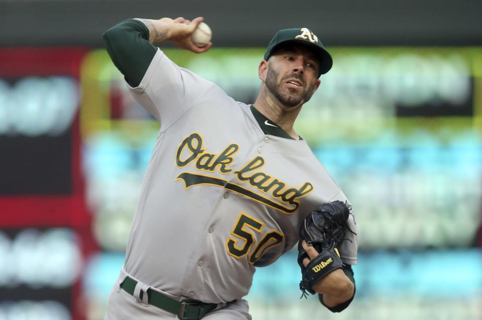 Oakland Athletics pitcher Mike Fiers throws to a Minnesota Twins batter during the first inning of a baseball game Thursday, July 18, 2019, in Minneapolis. (AP Photo/Jim Mone)