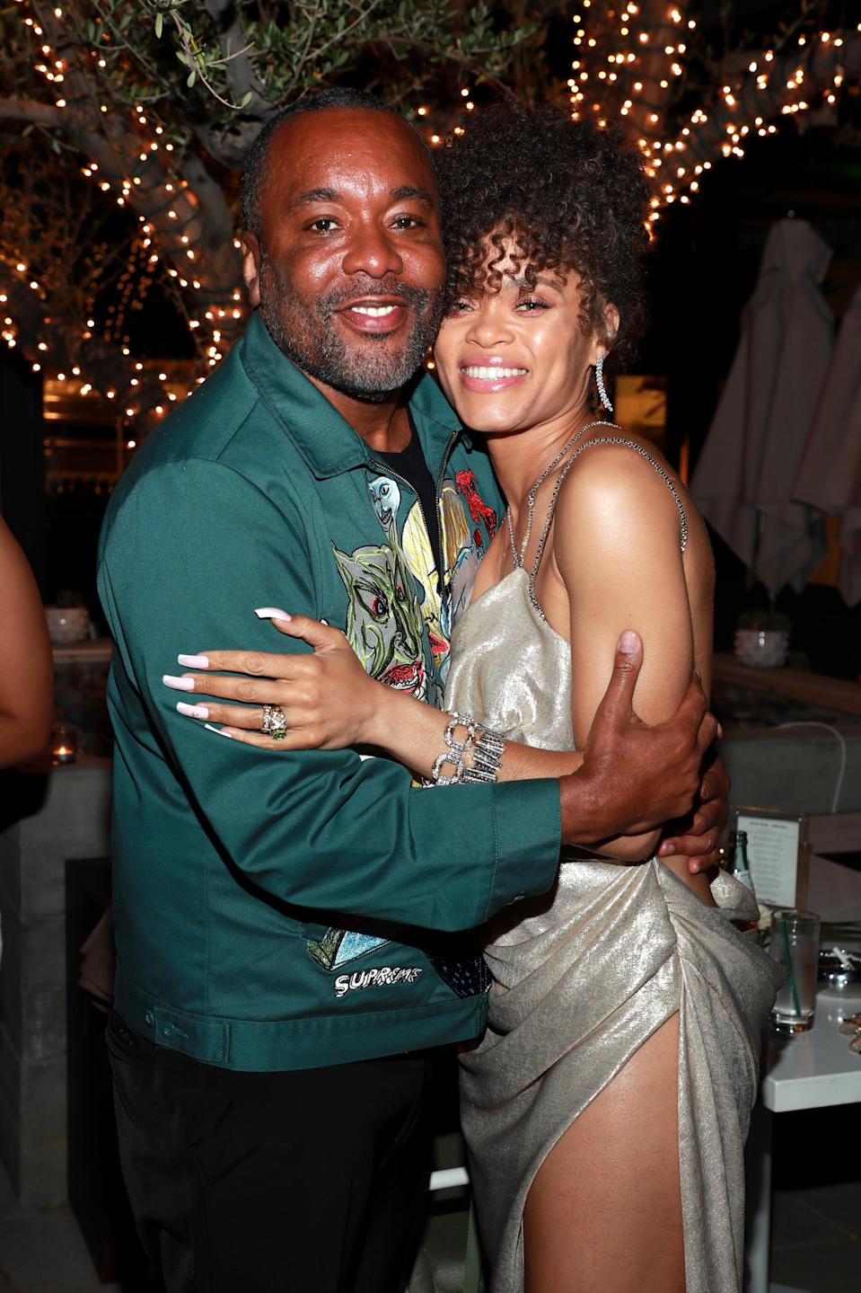 "Lee Daniels and Andra Day celebrate together at her after-party (she changed from her first golden <a href=""https://www.vanityfair.com/style/2021/04/inside-the-creation-of-andra-days-golden-oscar-look?mbid=synd_yahoo_rss"" rel=""nofollow noopener"" target=""_blank"" data-ylk=""slk:Vera Wang"" class=""link rapid-noclick-resp"">Vera Wang</a> gown to her second for the night)."