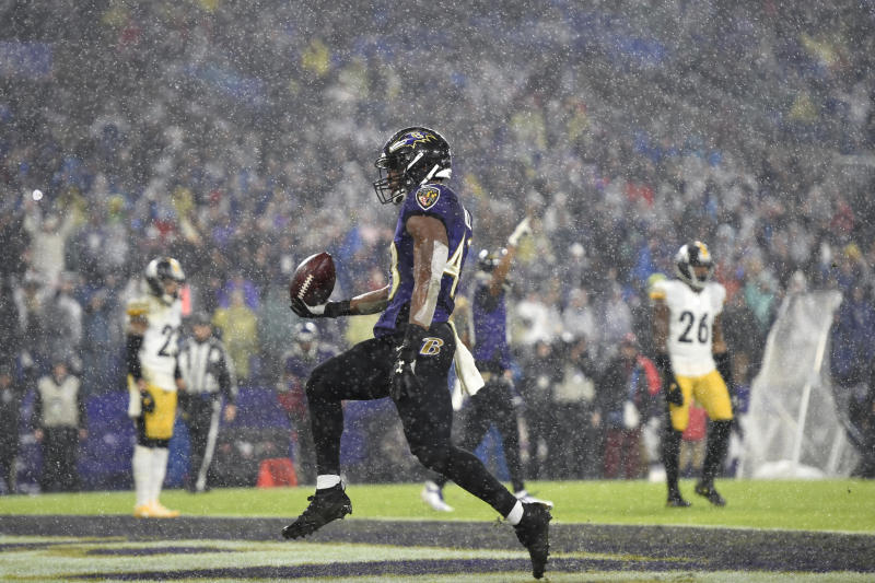 Baltimore Ravens running back Justice Hill reacts after scoring a rushing touchdown against the Pittsburgh Steelers during the first half of an NFL football game, Sunday, Dec. 29, 2019, in Baltimore. (AP Photo/Gail Burton)