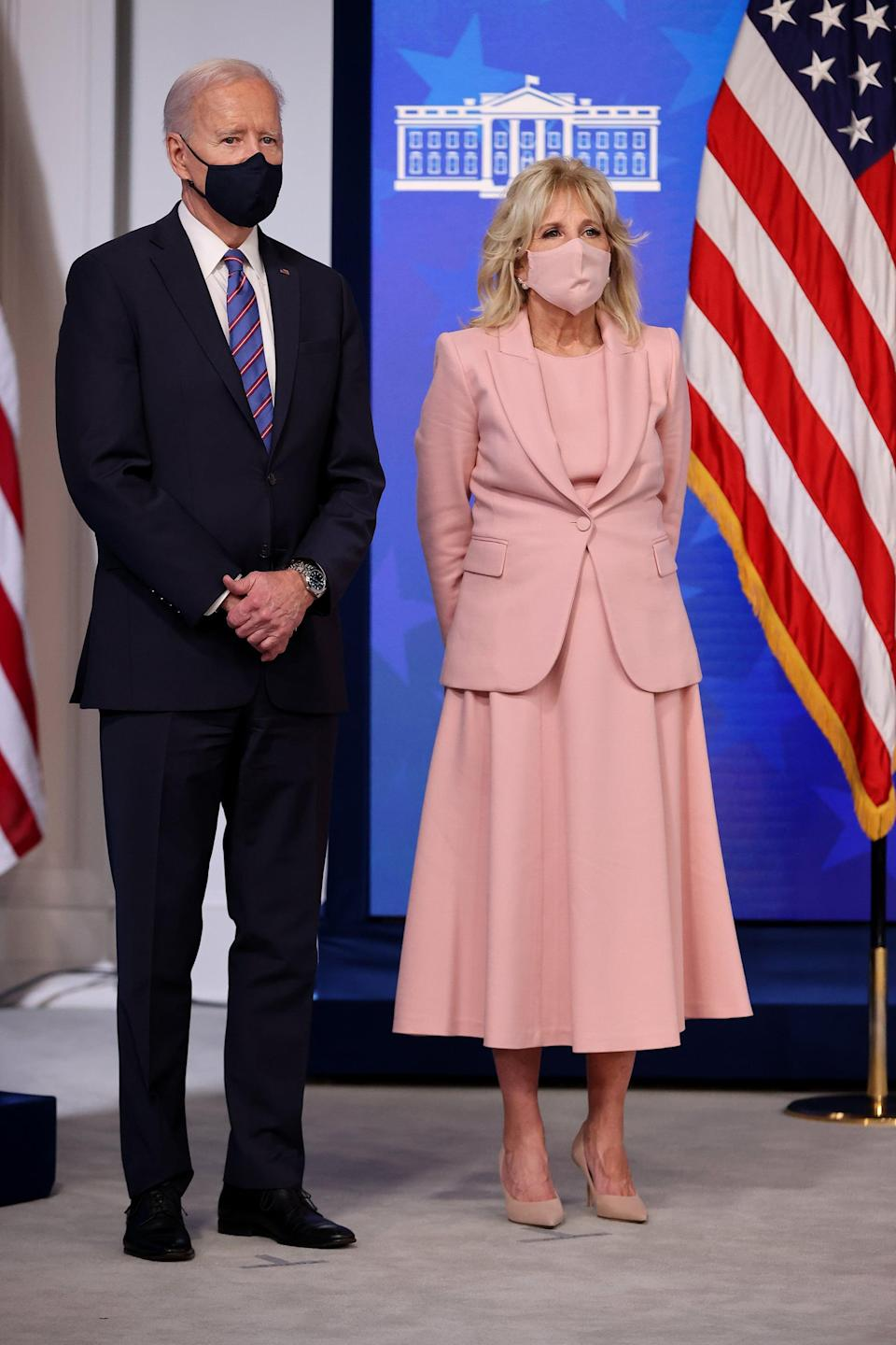 """<p>On Equal Pay Day in March 2021, Jill and Joe marked the occasion with an appearance in the Eisenhower Executive Office Building in Washington, DC. Jill chose a familiar shade of pink that she's worn before - perhaps due to its feminine tone on a day that is crucial for women - and finished the look with suede taupe Jimmy Choo heels and a <a href=""""https://www.popsugar.com/fashion/jill-biden-pearl-face-mask-lele-sadoughi-48224838"""" class=""""link rapid-noclick-resp"""" rel=""""nofollow noopener"""" target=""""_blank"""" data-ylk=""""slk:Lele Sadoughi pearl face mask"""">Lele Sadoughi pearl face mask</a> that she owns in three colors. Lisa """"Lele"""" Sadoughi started her women-owned accessories brand after working for Tory Burch, and then eventually launching her first line for J.Crew in 2006. The pack of face masks Jill has picked up reflect the significance behind pearls and their <a href=""""https://www.popsugar.com/fashion/kamala-harris-inauguration-chucks-pearls-trend-48116794"""" class=""""link rapid-noclick-resp"""" rel=""""nofollow noopener"""" target=""""_blank"""" data-ylk=""""slk:tie-in to the celebration of womanhood"""">tie-in to the celebration of womanhood</a>.</p>"""