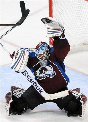 Colorado Avalanche goalie Jean-Sebastien Giguere makes a glove save in the third period of an NHL hockey game against the St. Louis Blues on Wednesday, Dec. 21, 2011, in Denver. The Avalanche won 3-2. (AP Photo/Chris Schneider)