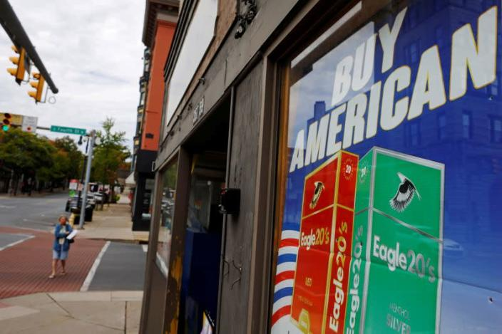 """FILE PHOTO: A sign reads """"Buy American"""" in shop window in Easton"""