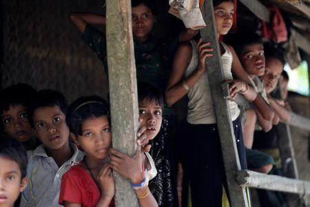 Rohingya Muslim children stand in U Shey Kya village outside Maungdaw in Rakhine state