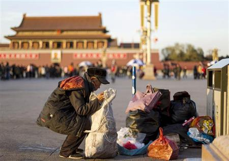 A man collects waste bottles at Tiananmen Square in central Beijing, December 4, 2013. REUTERS/Stringer/Files