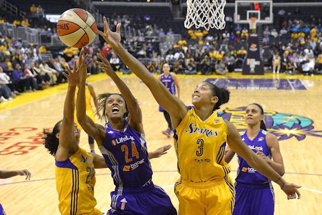 Phoenix Mercury forward DeWanna Bonner, second from left, reaches for a rebound along with Los Angeles Sparks guard Kristi Toliver, left, and center Candace Parker, second from right, as forward Candice Dupree looks on during the first half in Game 3 of a WNBA basketball Western Conference semifinal series, Monday, Sept. 23, 2013, in Los Angeles. (AP Photo/Mark J. Terrill)