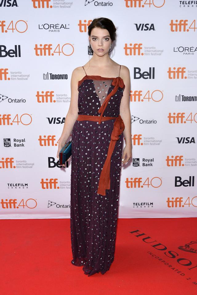 <p>The young actress looks bohemian in a long, flowing purple dress with her hair piled on top of her head.</p>