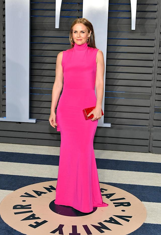 <p>Just days after announcing her split from husband Christopher Jarecki, the <em>Clueless</em> star was back on the party scene in a hot-pink number that would make Cher proud. (Photo: Dia Dipasupil/Getty Images) </p>