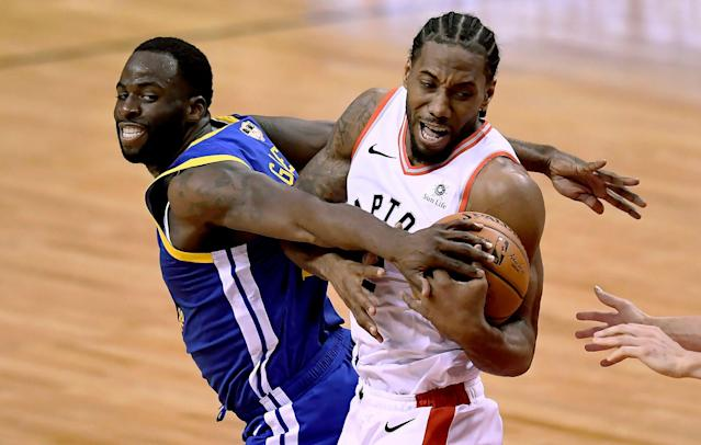 Golden State Warriors forward Draymond Green (23) tries to take the ball from Toronto Raptors forward Kawhi Leonard (2) during the second half of Game 2 of the NBA Finals on Sunday in Toronto. (Frank Gunn/The Canadian Press via AP)