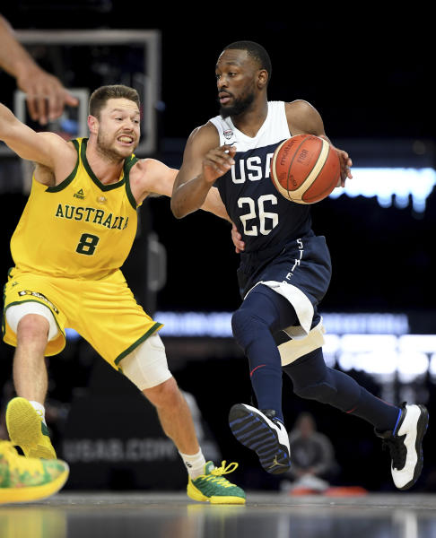 Australia's Matthew Dellavedova, left, and United States' Kemba Walker in action during their exhibition basketball game in Melbourne, Saturday, Aug. 24, 2019. (AP Photo/Andy Brownbill)