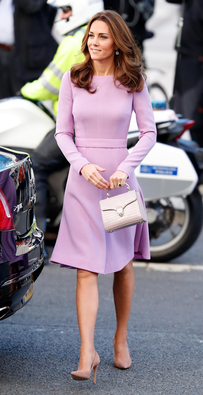 The Duchess of Cambridge opted for the Midi Mayfair Bag in lilac when she attended the Global Ministerial Mental Health Summit at London County Hall with husband Prince William in October 2018. (Getty Images)