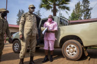 """FILE - In this Friday, Sept. 25, 2020 file photo, Paul Rusesabagina, whose story inspired the film """"Hotel Rwanda"""" for saving people from genocide, wears a pink prison uniform as he arrives for a bail hearing at a court in the capital Kigali, Rwanda. A court in Rwanda said Monday, Sept. 20, 2021 that Rusesabagina, who boycotted the announcement after declaring he didn't expect justice in a trial he called a """"sham"""", is guilty of terror-related offenses. (AP Photo/Muhizi Olivier, File)"""