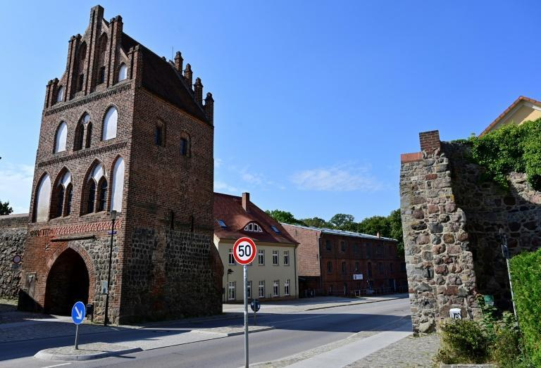 Still ringed by an intact medieval city wall, Merkel's hometown of Templin celebrates its 750th birthday this year belatedly due to the pandemic (AFP/John MACDOUGALL)
