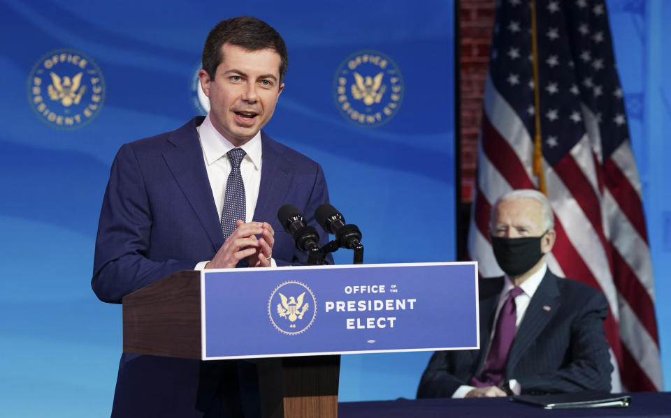 Former South Bend, Ind. Mayor Pete Buttigieg, President-elect Joe Biden's nominee to be transportation secretary reacts to his nomination as Biden looks on during a news conference at The Queen theater in Wilmington, Del., on Dec. 16, 2020. (Kevin Lamarque/Pool via AP)
