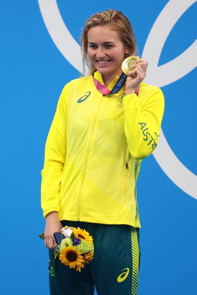 """Ariarne Titmus of Team Australia waves during the medal ceremony after winning gold in the Women's 400-m freestyle final on day three of the Tokyo 2020 Olympic Games at Tokyo Aquatics Centre on July 26, 2021 in Tokyo, Japan.<span class=""""copyright"""">Abbie Parr—Getty Images</span>"""