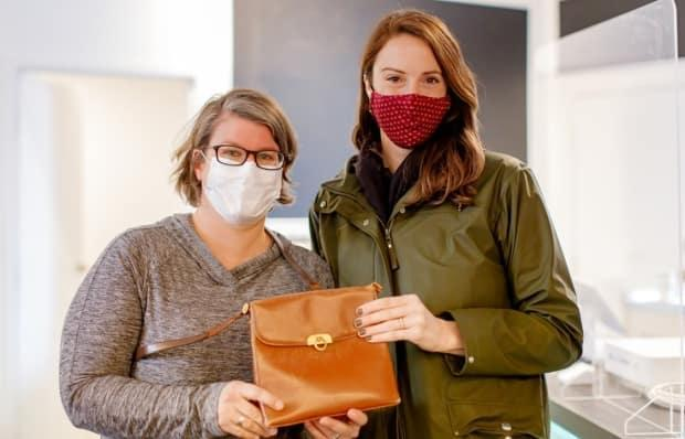 In a frenzy of decluttering, Jessica Fritz sold this purse at a consignment shop. With a post to social media, she was able to track down buyer Ellen Egan, who graciously sold it back to her.  (Jenna Rachelle - image credit)