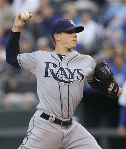Tampa Bay Rays pitcher Jeremy Hellickson throws to home plate during the first inning of a baseball game against the Kansas City Royals at Kauffman Stadium in Kansas City, Mo., Wednesday, May 1, 2013. (AP Photo/Colin E. Braley)