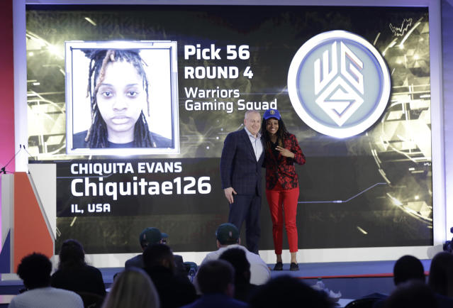 Chiquita Evans poses for photographs with Brendan Donohue after being selected as the 56th pick overall by the Warriors Gaming Squad at the NBA 2K League draft Tuesday, March 5, 2019, in New York. Evans is the first woman selected in the esports league. (AP Photo/Frank Franklin II)