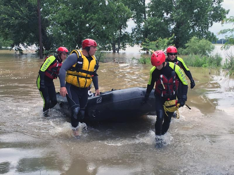 Rescuers return from checking on flooded homes in Horseshoe Bend, Texas along the Brazos River on Wednesday. (Yahoo News/Jason Sickles)