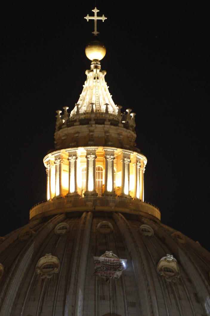 A banner protesting Italian Premier Mario Monti, Europe and multinationals hangs from a window of St. Peter's dome at the Vatican, Tuesday, Oct. 2, 2012. (AP Photo / Alessandra Tarantino)
