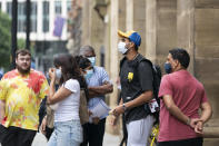 Members of Indian cricket team including Ishant Sharma, centre right, leave The Edwardian Manchester hotel where the team were staying in Manchester, England, Saturday, Sept. 11, 2021. The fifth and final test of the cricket series between England and India was cancelled on Friday in Manchester amid health concerns among India's players following a coronavirus outbreak in their camp. (AP Photo/Jon Super)