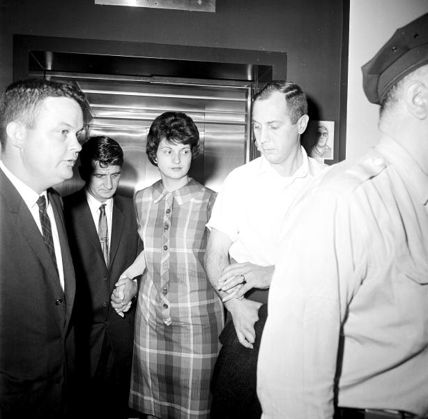 FILE - In this May 5, 1964 file photo, Dora Fronczak, whose baby was stolen from her arms in Michael Reese Hospital in Chicago, leaves the hospital with her husband, Chester. The baby was 37 hours old when a woman dressed as a nurse entered the room and took the child from Mrs. Fronczak, saying she was taking it to the nursery for examination. No trace of the child has been found since. (AP Photo/Harry L. Hall, File)