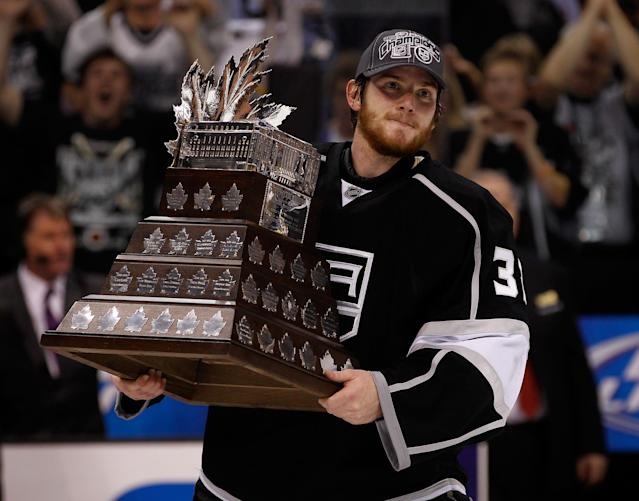 LOS ANGELES, CA - JUNE 11: Goaltender Jonathan Quick #32 of the Los Angeles Kings holds the Conne Smythe Trophy for the Most Valuable Player in the NHL Playoffs after the Los Angeles Kings defeated the New Jersey Devils 6-1 in Game Six to win the series 4-2 of the 2012 Stanley Cup Final at Staples Center on June 11, 2012 in Los Angeles, California. (Photo by Bruce Bennett/Getty Images)