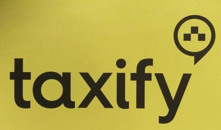 FILE PHOTO:Taxify logo is pictured on a taxi cab in Riga