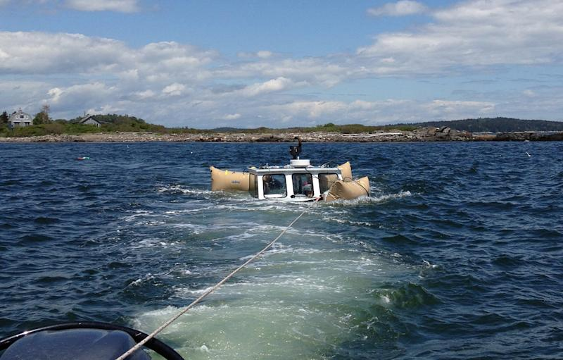 "In this handout photo provided by Verian Tuttle that was taken Sunday, June 9, 2013, the lobsterboat ""Queen Tut"" owned by Philip Tuttle is floated and towed to a dock in Harpswell, Maine. Tuttle, a 90-year-old lobsterman, survived the sinking of his boat by swimming to a nearby island through the icy waters of the Gulf of Maine. (AP Photo/Verian Tuttle)"