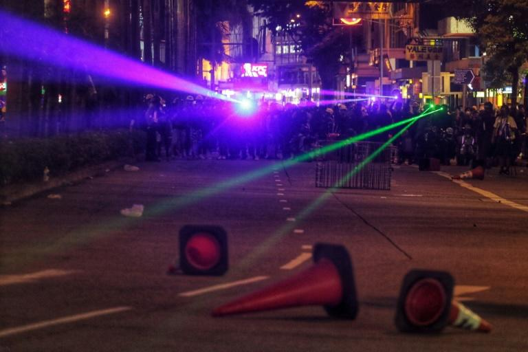 Demonstrators have held 'lightshows' outside of police stations and at most public gatherings, lending the protests a somewhat surreal disco-vibe once the sun sets (AFP Photo/Vivek Prakash)