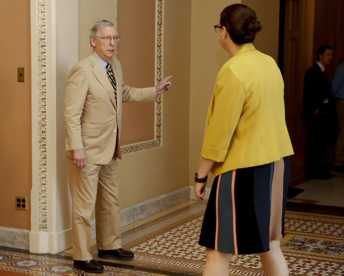 "Senate Majority Leader Mitch McConnell of Ky., talks with Secretary for the Majority Laura Dove, as he walks to his office on Capitol Hill in Washington, Monday, June 26, 2017. Senate Republicans unveil a revised health care bill in hopes of securing support from wavering GOP lawmakers, including one who calls the drive to whip his party's bill through the Senate this week ""a little offensive."" (AP Photo/Carolyn Kaster)"