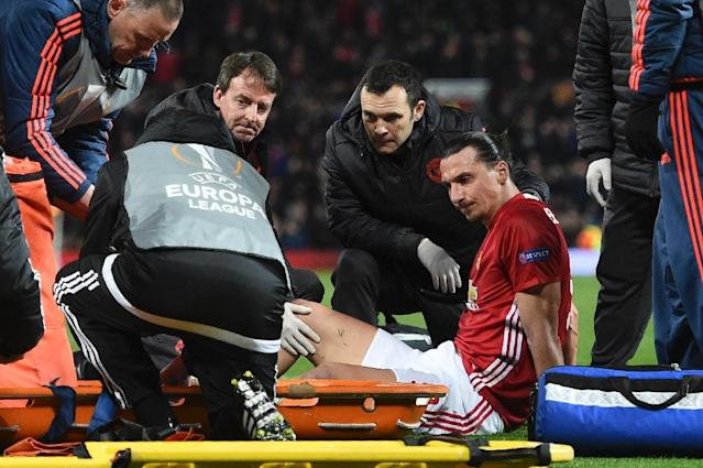 Zlatan Ibrahimovic gets treatment after injuring his knee during Manchester United's UEFA Europa League quarter-final second leg against Anderlecht at Old Trafford in Manchester, on April 20, 2017 (AFP Photo/Oli SCARFF )
