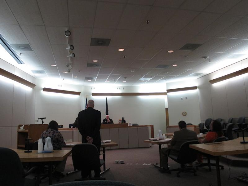 District Attorney David Brower, standing, addresses state court Judge David George during sentencing of John Marvin Jr., on Friday, April 5, 2013, in Juneau, Alaska. Marvin was sentenced to two consecutive sentences of 99 years in the deaths of two police officers. (AP Photo/Becky Bohrer)