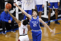 Duke forward Matthew Hurt (21) tries to block the shot of Louisville guard Carlik Jones (1) during the first half of an NCAA college basketball game in the second round of the Atlantic Coast Conference tournament in Greensboro, N.C., Wednesday, March 10, 2021. (AP Photo/Gerry Broome)